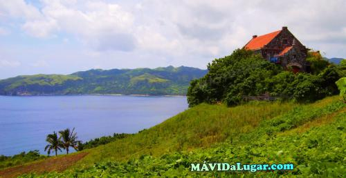 A house on a hill overlooking the sea in Batanes